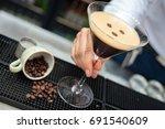 espresso martini cocktail being ... | Shutterstock . vector #691540609