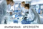 team of medical research... | Shutterstock . vector #691541074