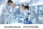 team of medical research... | Shutterstock . vector #691541086