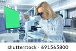 female research scientist looks ... | Shutterstock . vector #691565800