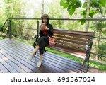 beautiful asian woman sit on... | Shutterstock . vector #691567024
