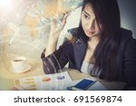 businesswoman working on table... | Shutterstock . vector #691569874