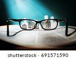eyeglasses lie on the open... | Shutterstock . vector #691571590