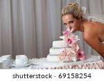 bride near a wedding cake with...   Shutterstock . vector #69158254