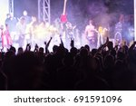 rear view of crowd with arms... | Shutterstock . vector #691591096