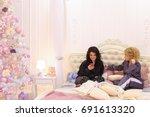 brunette girl uses smartphone...   Shutterstock . vector #691613320