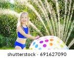 adorable little girl playing... | Shutterstock . vector #691627090