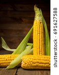 ripe yellow sweet corn cob on a ... | Shutterstock . vector #691627588