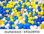 happy little girl having fun in ... | Shutterstock . vector #691628950