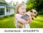 cute little girl holding her... | Shutterstock . vector #691628974