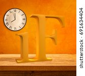 Small photo of Intermittent Fasting acronym on wooden table against orange wall with clock