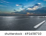 asphalt road and the beautiful... | Shutterstock . vector #691658710