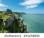 hiker on the headland in valley ... | Shutterstock . vector #691658830