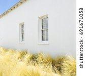 Small photo of White Adobe House Wild Grass Marfa Texas