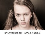 a portrait of the serious girl... | Shutterstock . vector #691671568