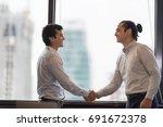 business partners handshaking... | Shutterstock . vector #691672378