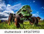 old tractor in the alpine... | Shutterstock . vector #691673953