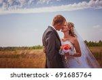 kissing wedding couple in high... | Shutterstock . vector #691685764