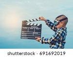 kid playing film clapper board... | Shutterstock . vector #691692019