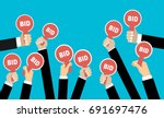 hands holding auction paddle.... | Shutterstock .eps vector #691697476