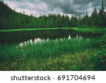 mountain beautiful wild lake... | Shutterstock . vector #691704694