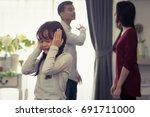 rising family problems hurt... | Shutterstock . vector #691711000