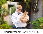 red cat in the hands of stylish ... | Shutterstock . vector #691714318