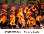 fried meat on the fire | Shutterstock . vector #691721638