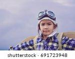 child pretend to be pilot. kid... | Shutterstock . vector #691723948