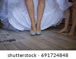 the bride in her dress is... | Shutterstock . vector #691724848