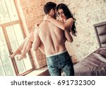 sexy young couple at home.... | Shutterstock . vector #691732300
