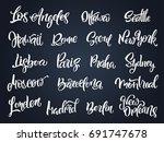 set of handwritten city names.... | Shutterstock .eps vector #691747678