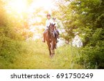two rider woman on horses going ... | Shutterstock . vector #691750249