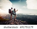 two hikers relax on top of a... | Shutterstock . vector #691751179
