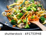 wok stir fry with vegetables... | Shutterstock . vector #691753948