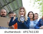 group of protesting young... | Shutterstock . vector #691761130