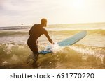 man going to surfing  walking... | Shutterstock . vector #691770220