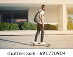 portrait of man with skate... | Shutterstock . vector #691770904