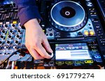 dj mixes the track in the... | Shutterstock . vector #691779274