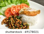 Thai spicy food, stir fried chicken whit basil on rice. - stock photo