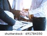 engineers shaking hands