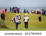 Small photo of Kingsbarns, St Andrews Scotland, 6th August 2017. Caroline Masson and her caddie enjoy a chat during the final round of the Ricoh Women's British Open