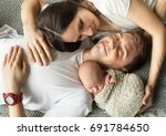 happy family with new born baby   Shutterstock . vector #691784650