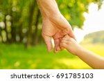 hands happy parents and child... | Shutterstock . vector #691785103