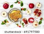apple  pomegranate and honey ... | Shutterstock . vector #691797580