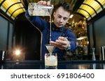 expert bartender is making... | Shutterstock . vector #691806400