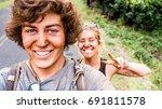 boyfriend making selfie picture ... | Shutterstock . vector #691811578