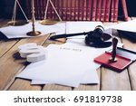 law act on old wooden desk in... | Shutterstock . vector #691819738