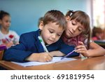 lesson. little schoolchildren... | Shutterstock . vector #691819954