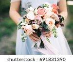 wedding bouquet in bride's... | Shutterstock . vector #691831390